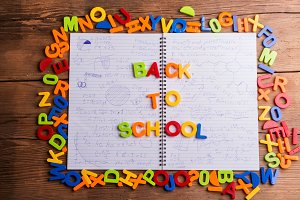 Colorful plastic letters, back to school, notebook with formulas