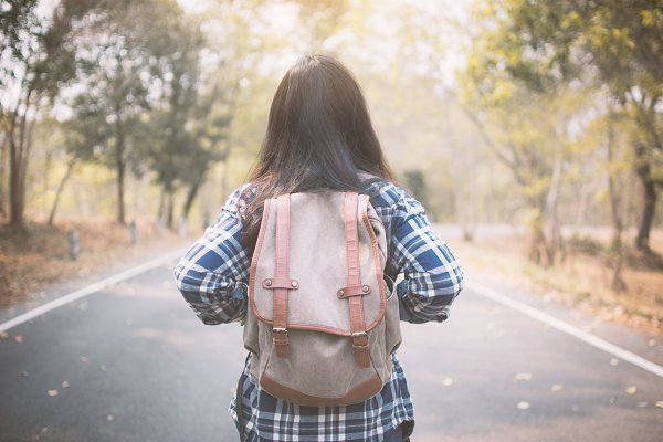 woman backpack in the road