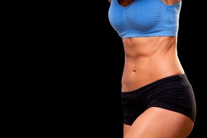abs. Sporty beautiful woman doing fitness exercising at black background to stay fit. Fitness workout motivation. perfect body