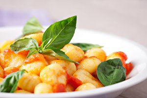 Gnocchi with tomato mozzarella and b