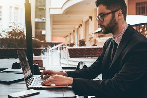 Bearded businessman with laptop