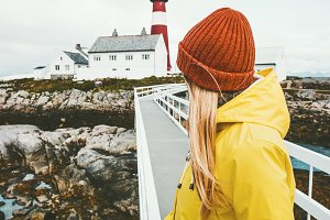 Woman sightseeing Norway lighthouse