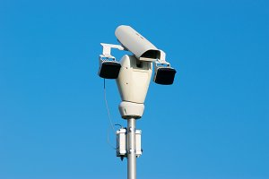 Surveillance Camera and Blue Sky