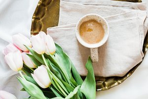 Coffee and Tulips in Bed Stock