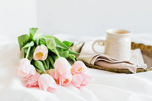 Pink Tulips on Bed with Coffee