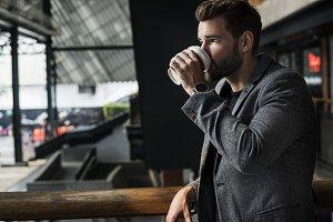 Man drinking hot coffee