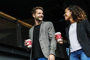 Partners having take away coffee