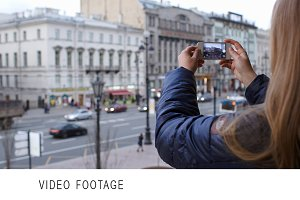 Woman with smartphone taking picture