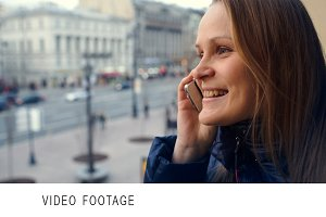 Emotional woman having a phone talk