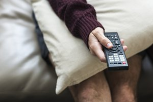 Holding television remote control