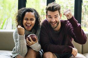 Couple watching american football