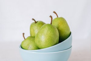 Green pears on a light background