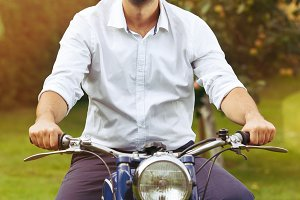 handsome man on retro motorbike