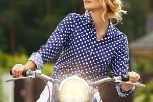 beautiful girl on retro motorbike