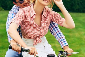 beautiful couple on retro motorbike