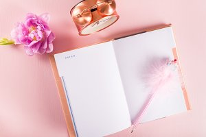 Open Notebook for writing Dreams and Ideas with flowers nearby