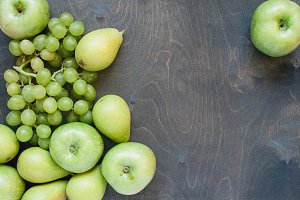 Green fruits on the wooden table
