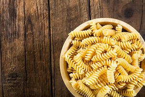 Raw Pasta Fusilli in Wooden Bowl