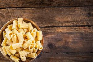 Raw Pasta  Mezzi Rigatoni in Wooden Bowl