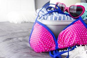 Pink bikini and summer accessories
