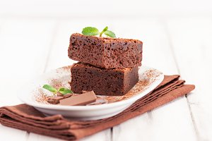 Chocolate brownie square pieces.