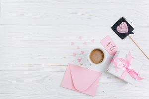 Gift, cup of coffee and paper hearts
