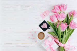 Pink tulips, gift and cup of coffee