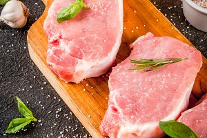 Raw beef and pork steaks