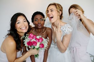 Cheerful bridesmaids with the bride