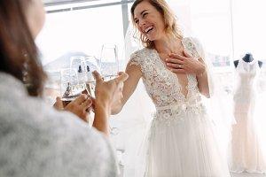 Bride toasting champagne