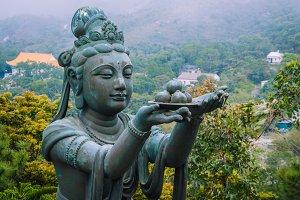 Bronze buddhistic statues praising and making offerings to the Tian Tan Buddha - Big Buddha
