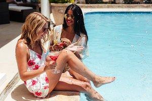 Best friends enjoying at resort pool