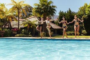 Women friends jumping
