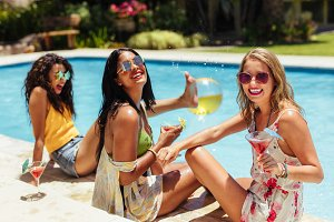 Women having great time at poolside
