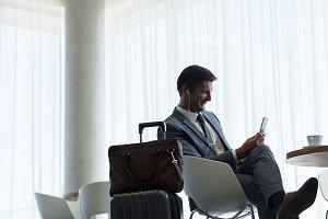 Businessman sitting at airport