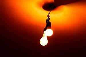 Dramatic two orange indoor lamps