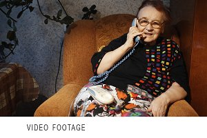 Old woman receiving a phone call