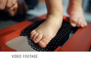 Child foot on orthopedic device