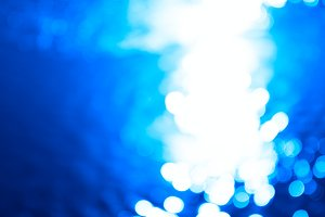 Horizontal blue water bokeh background