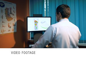 Man using foot scan to define