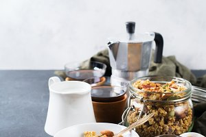 Breakfast with black coffee muesli granola honey nuts milk