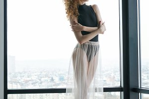 Slender ballerina in silk skirt