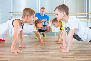 Children at physical education lesson in school gym gymnast kid
