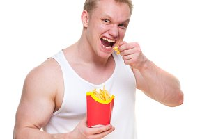Diet failure of fat man eating french fries fast food. Portrait of overweight person who spoiled healthy meal . Junk meal leads to obesity. Disruption from diet concept. He is trying to go on a diet