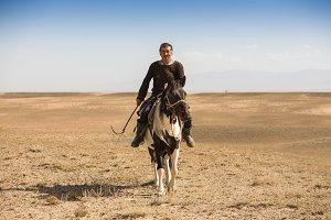 Normal steppe groom, who is tending the horses in Kazakhstan