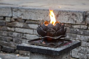 Beautiful lotus candle for worship on black background.