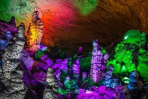 beautiful illuminated multicolored stalactites from karst Reed Flute cave. Guilin Guangxi  China