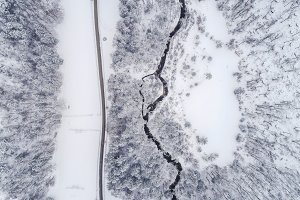 Aerial view of river & winter forest