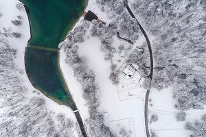 Aerial view of lake & winter forest