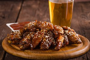 Grilled chicken wings with hot sauce